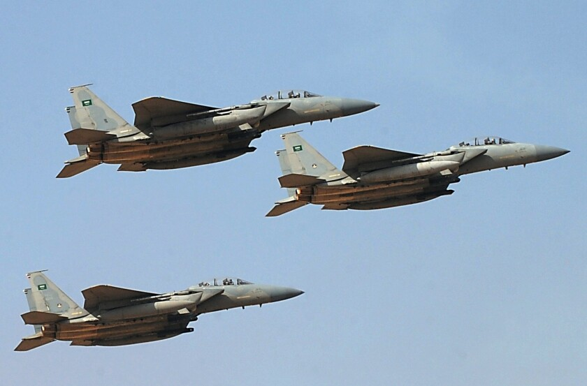Jet fighters of the Saudi Royal air force perform during a 2013 ceremony in Riyadh. Analysts say a nascent Arab military alliance announced over the weekend could complicate already tangled national conflicts.