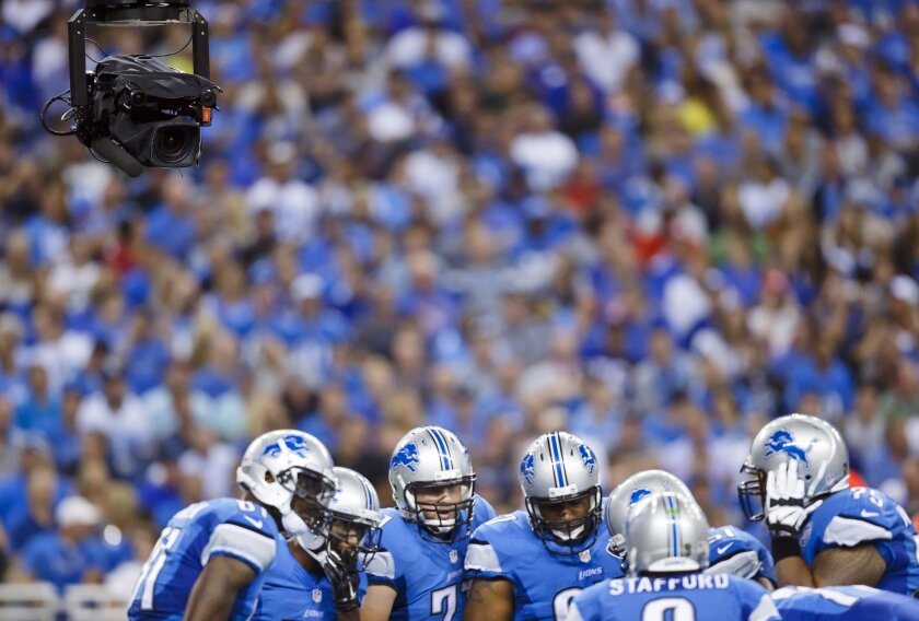 Detroit fans cheer on the Lions at Ford Field on Sept. 8, 2014. The team plans to host a gay pride event at an upcoming game in October.