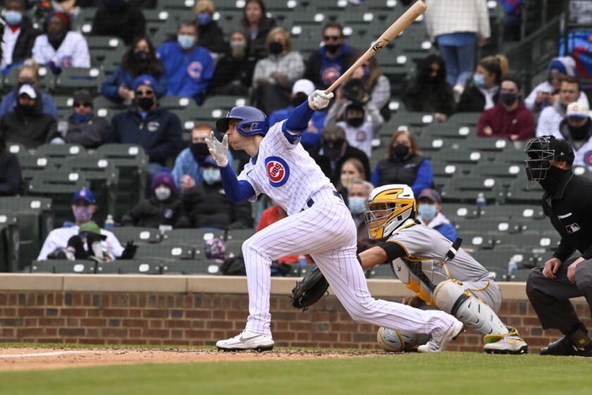 Chicago Cubs' Matt Duffy (5) hits an RBI single during the seventh inning of a baseball game against the Pittsburgh Pirates, Saturday, May 8, 2021, in Chicago. (AP Photo/Matt Marton)
