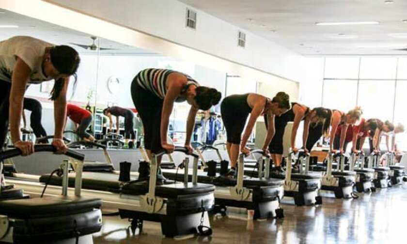 Exercise at Pilates Plus La Jolla is performed on machines that feature spring resistance. Courtesy Photo