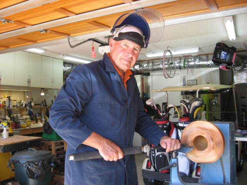 Joel Gerber using the lathe in his garage.