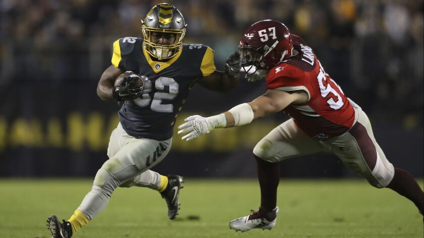 San Diego Fleet running back Ja'Quan Gardner (32) tries to stiff arm San Antonio Commanders offensive lineman Mason Gentry (57) during a run after the catch in the second half during a San Antonio Commanders.