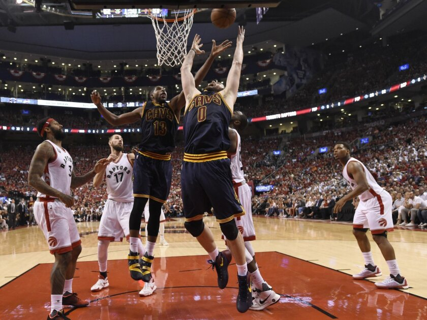 Cleveland Cavaliers forward Kevin Love and guard Tristan Thompson jump for a rebound as Raptor players watch during the second half of Game 6 of the NBA basketball Eastern Conference finals, Friday, May 27, 2016, in Toronto. (Frank Gunn/The Canadian Press via AP)