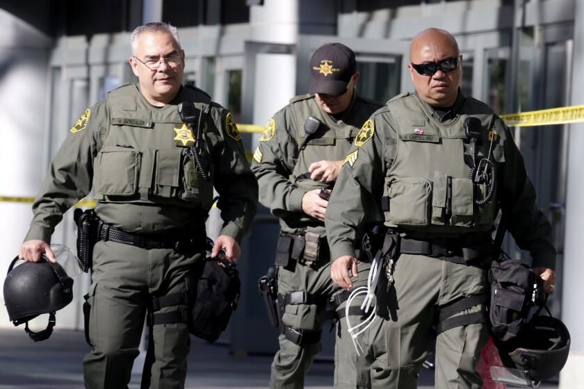 Orange County Sheriff's deputies prepare for a Donald Trump rally.