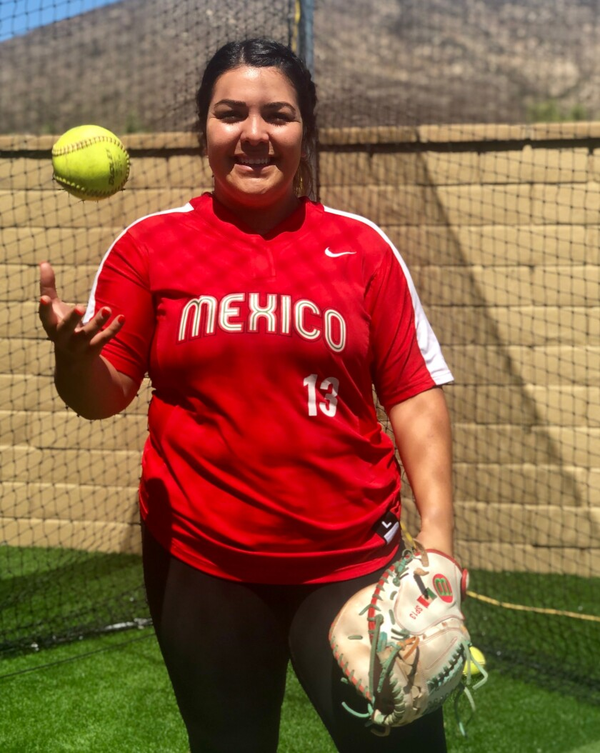 Sashel Palacios, 23, catcher of the Mexican women's softball team poses at her home in Chula Vista, California.