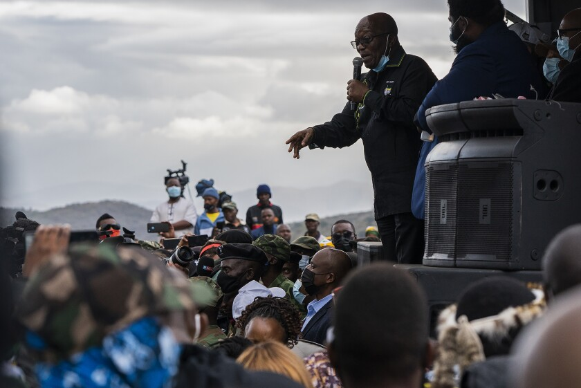 Former president Jacob Zuma addresses his supporters at his home in Nkandla, KwaZulu-Natal Natal Province, Sunday, July 4, 2021. The Constitutional Court will hear Zuma's urgent application on July 12 to rescind its order sentencing him to jail for 15 months for contempt of court. Zuma was initially supposed to hand himself over to authorities for his incarceration by Sunday. (AP Photo/Shiraaz Mohamed)