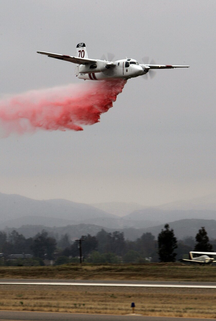 A Cal Fire S-2T tanker dispensed fire retardant during a demonstration at the Ramona Air Attack Base in 2009.