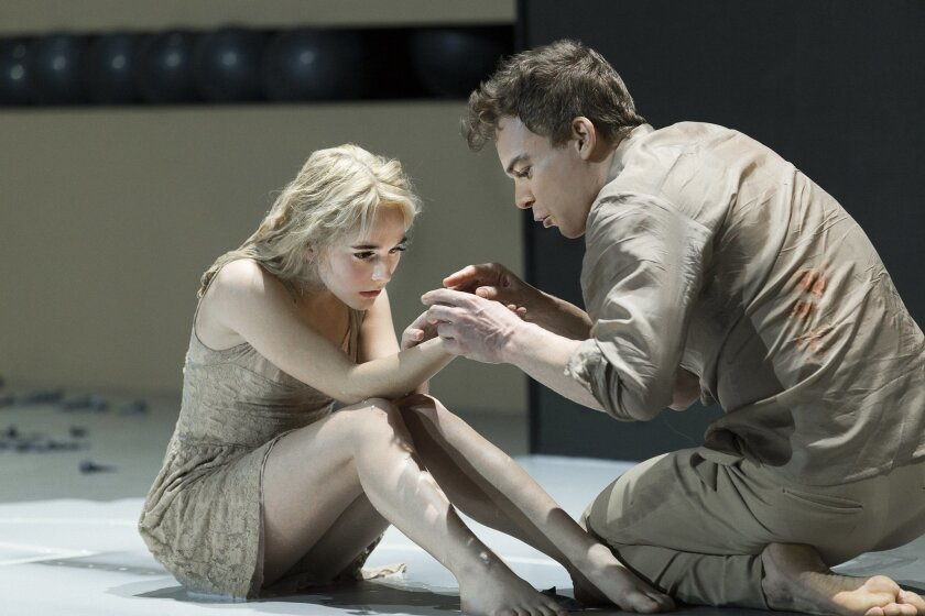 "In this undated photo provided by Matt Ross Public Relations, Sophia Anne Caruso, left, and Michael C. Hall perform in a scene from David Bowie and Enda Walsh's ""Lazarus,"" currently performing off-Broadway at the New York Theatre Workshop in New York. (Jan Versweyveld/Matt Ross Public Relations via AP)"