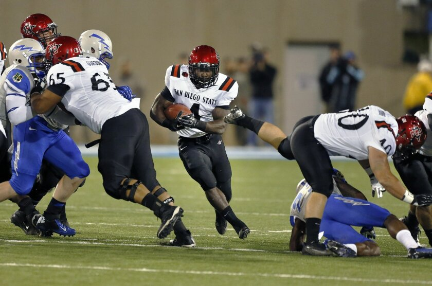 San Diego State running back Adam Muema finds a hole as he runs with the ball during the first quarter of an NCAA college football game against Air Force.
