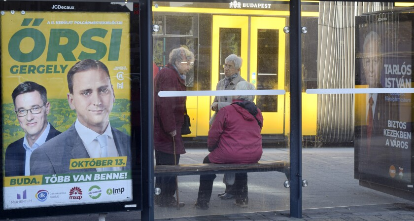 In this picture taken on Tuesday, Oct. 8, 2019, electoral posters are displayed at a tram stop in Budapest, Hungary. Budapest Mayor Istvan Tarlos is running for a third term and his main challenger is Gergely Karacsony, who is backed by several left-wing, liberal and green parties. Hungary will hold nationwide municipal elections on Oct. 13. (AP Photo/Pablo Gorondi)
