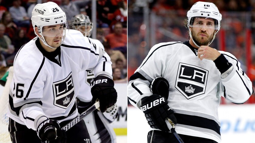 The Kings have handled the legal problems of defenseman Slava Voynov, left, and center Mike Richards in much different fashions.