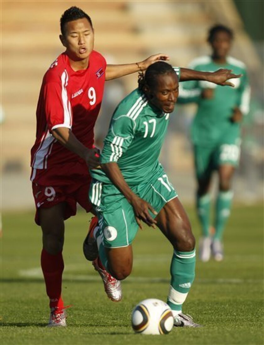 Nigeria'S Chidi Odiah, right, is chased by North Kore's Jong Tae Se during a warmup match at the Makhulong stadium in Tembisa, ouskirts Johannesburg, Sunday, June 6, 2010. Both teams are playing to prepare for the upcoming World Cup, which gets underway on June 11. North Korea will play in group G,