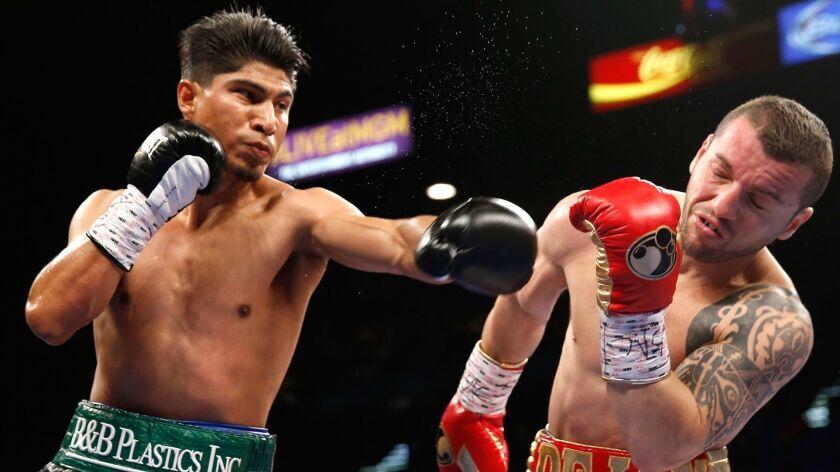 Mikey Garcia, left, connects against Dejan Zlaticanin on Jan. 28, 2017, in Las Vegas.