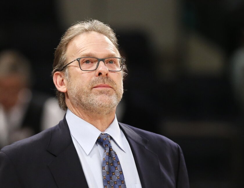 New York Knicks interim head coach Kurt Rambis, coaching his first game in place of Derek Fisher, who's was fired Monday, stands watches from the bench in the first half of an NBA basketball game between the New York Knicks and the Washington Wizards at Madison Square Garden in New York, Tuesday, F