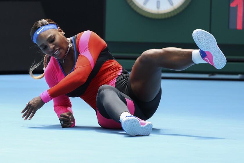 United States' Serena Williams falls during her fourth round match against Aryna Sabalenka of Belarus at the Australian Open tennis championship in Melbourne, Australia, Sunday, Feb. 14, 2021.(AP Photo/Hamish Blair)
