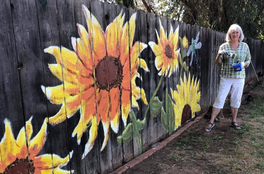 Artist Janice Reich's first 'Quarantine mural,' for a friend bored of staring at a blank backyard fence.