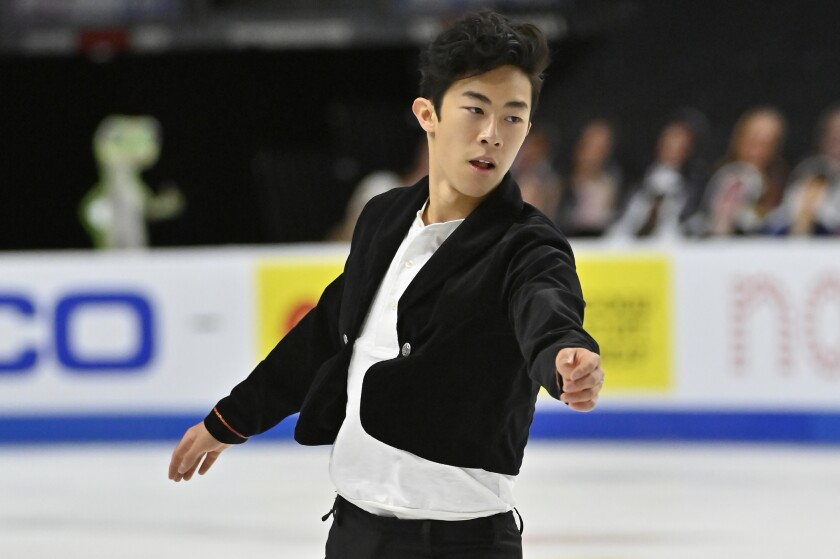 Nathan Chen competes in the men's short program in the International Skating Union Grand Prix of Figure Skating series.