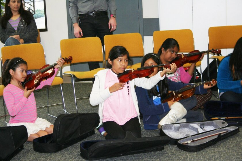 In partnership with San Diego Youth Symphony and Conservatory, Casa de Amistad of Solana Beach kicked off its after-school music program Jan. 13. The pilot program will teach introductory violin, viola and cello to 20 students in fourth through sixth grade. 'All kids should have access to music,' says Nicole Mione-Green of Casa de Amistad.