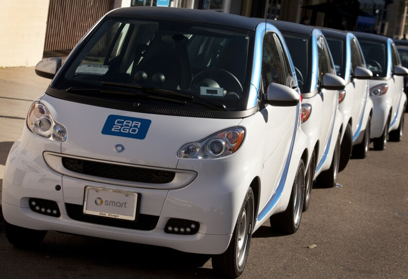 Cars at the Car2Go office on Ninth Avenue in East Village wait to be picked up
