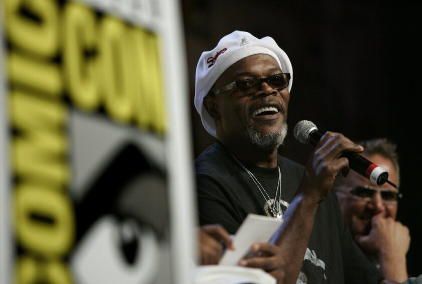 """Samuel L. Jackson answers a fans' question during a panel for """"Snakes on a Plane at 2006's San Diego Comic Con."""