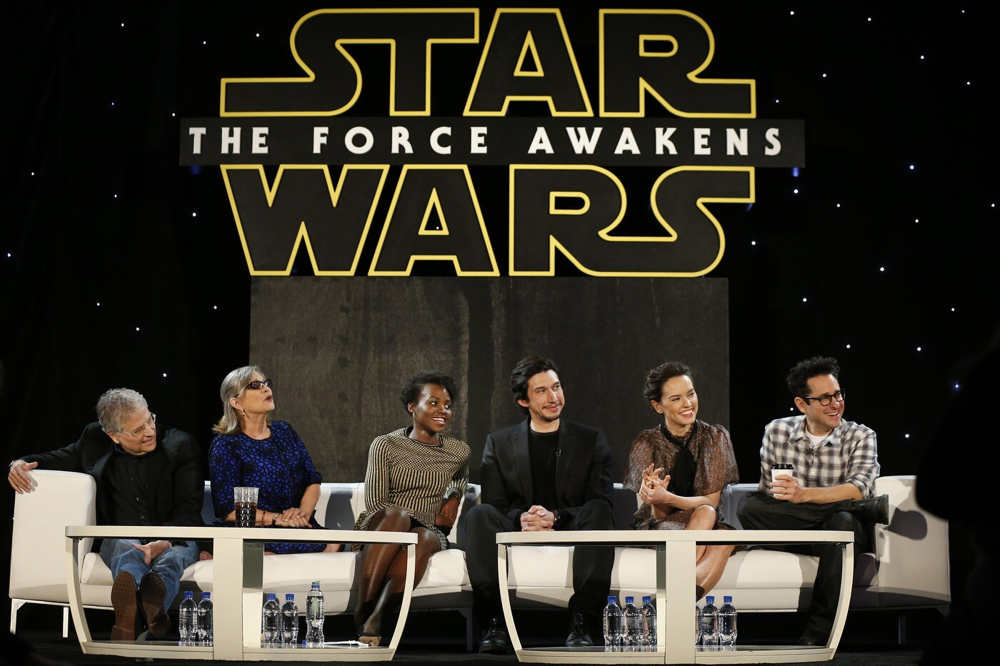 """A press junket in L.A. for """"Star Wars: The Force Awakens"""" features writer Lawrence Kasdan, from left, Carrie Fisher, Lupita Nyong'o, Adam Driver, Daisy Ridley and J.J. Abrams."""
