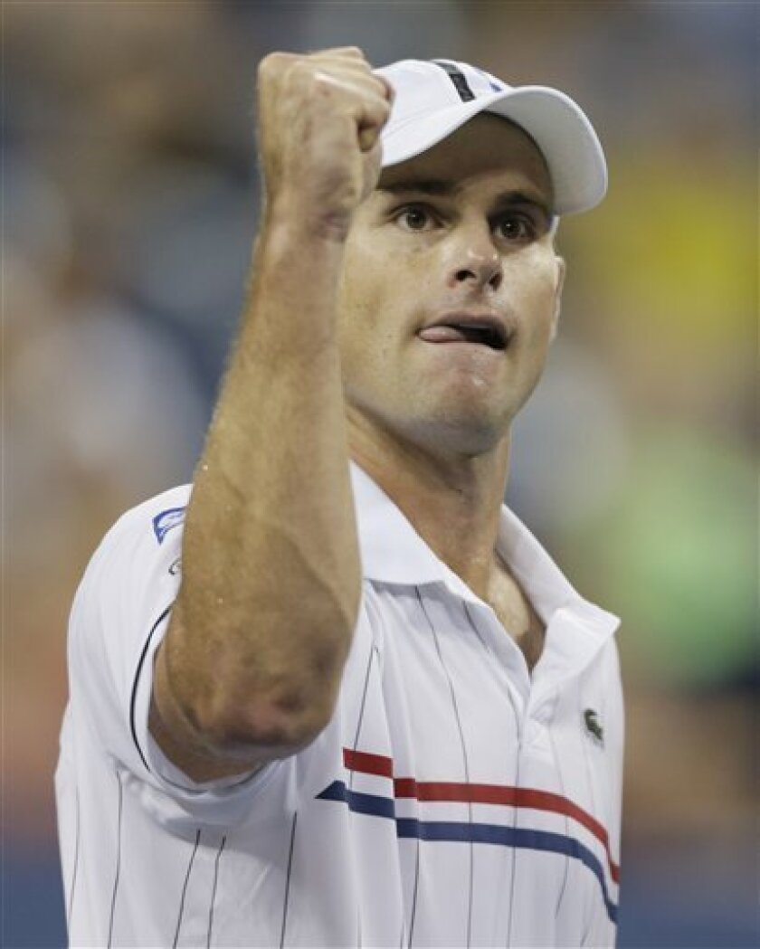 Andy Roddick reacts during his match against  Australia's Bernard Tomic in the third round of play at the 2012 US Open tennis tournament,  Friday, Aug. 31, 2012, in New York. Roddick won the match. (AP Photo/Charles Krupa)