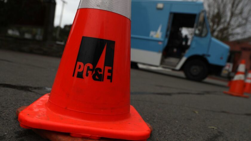 A traffic cone sits next to a Pacific Gas & Electric Co. truck in Fairfax, Calif.