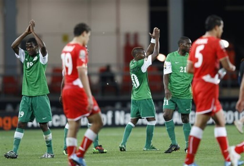 Zambia players  applaud  towards fans after drawing 1-1 with Tunisa in their African Cup of Nations Group D soccer match at Tundavala Stadium in Lubango, Angola Wednesday, Jan. 13, 2010. (AP Photo/Rebecca Blackwell)
