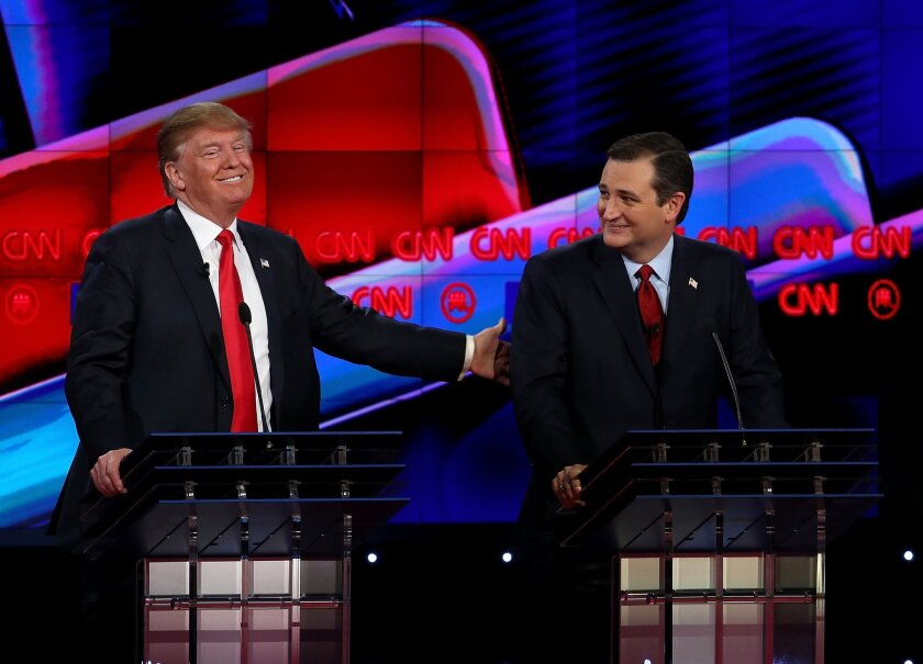 Republican presidential candidates Donald Trump and Sen. Ted Cruz interact during the CNN Republican presidential debate in Las Vegas on Dec. 15.