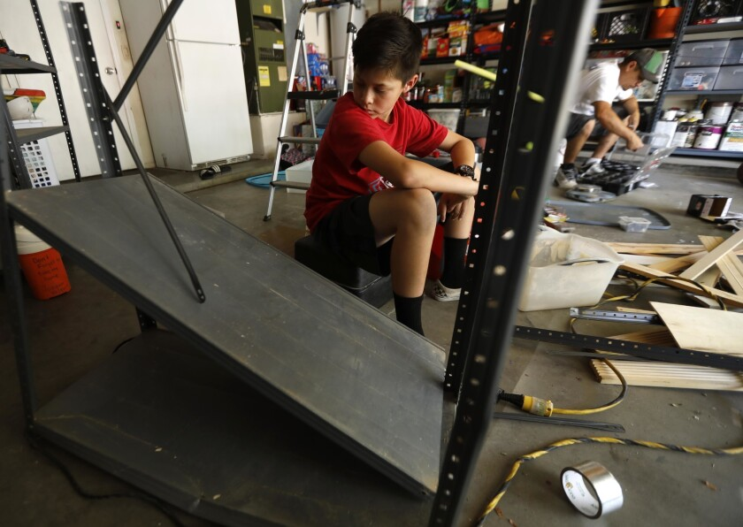 RIDGECREST, CA - JULY 9, 2019 - Joaquin Vasquez, 12, looks over earthquake damaged shelves as his