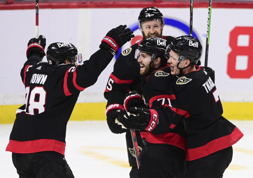 Ottawa Senators center Chris Tierney (71) celebrates a goal against the Toronto Maple Leafs with teammates during the second period of an NHL hockey game Friday, Jan. 15, 2021, in Ottawa, Ontario. (Sean Kilpatrick/The Canadian Press via AP)