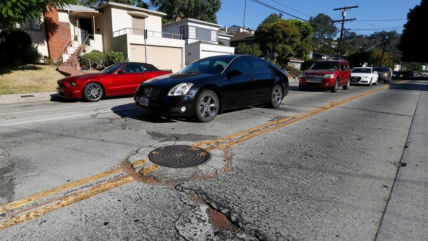 The streets are cracked and patched at Griffith Park Boulevard and Tracy Street in Silver Lake.