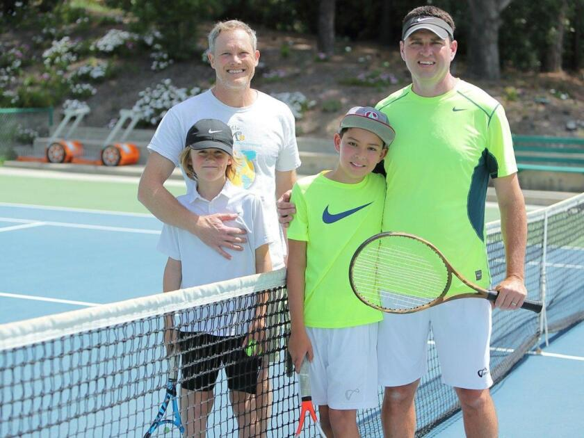 Christian and Ethan Carson and Tyler and Scott Kreit at this year's family tournament at the RSF Tennis Club.