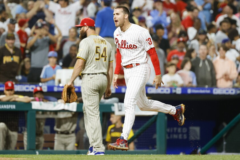 The Phillies' Brad Miller celebrates hitting a walk off double