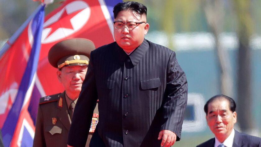 FILE - In this April 13, 2017 file photo, North Korean leader Kim Jong Un, center, is accompanied b