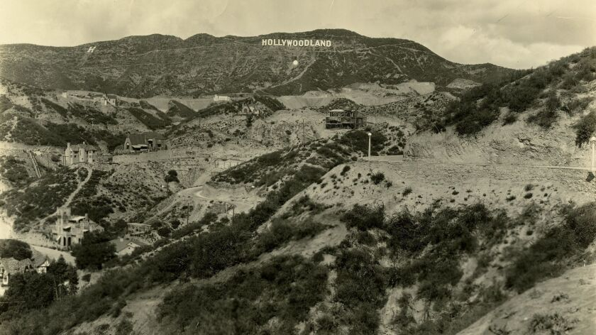 An image by an unknown photographer captures the old Hollywoodland sign in the 1920s.