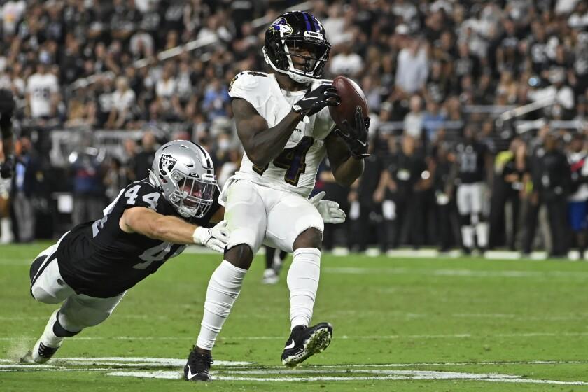 Baltimore Ravens wide receiver Sammy Watkins (14) makes a catch Las Vegas Raiders inside linebacker Nick Kwiatkoski (44) during the second half of an NFL football game, Monday, Sept. 13, 2021, in Las Vegas. (AP Photo/David Becker)