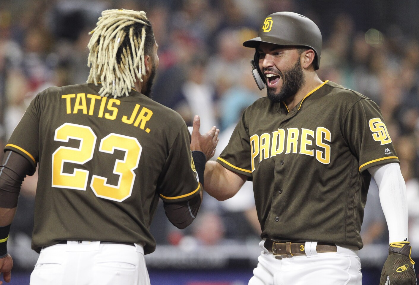 The Padres' Eric Hosmer, right, and Fernando Tatis Jr. celebrate Hosmer's home run just after Tatis hit a home run in the sixth inning against the Cardinals at Petco Park on Friday, June 28, 2019 in San Diego, California.