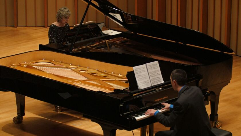 Susan Svrcek and Nic Gerpe perform Schoenberg's two-piano arrangement of his Second Chamber Symphony for a Piano Spheres concert at Zipper Concert Hall on Tuesday night.
