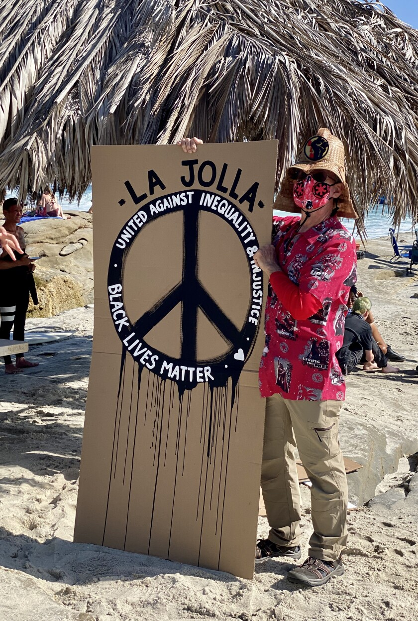 Many protesters at the June 8 paddle-out at Windansea Beach wore masks amid the continuing coronavirus outbreak.