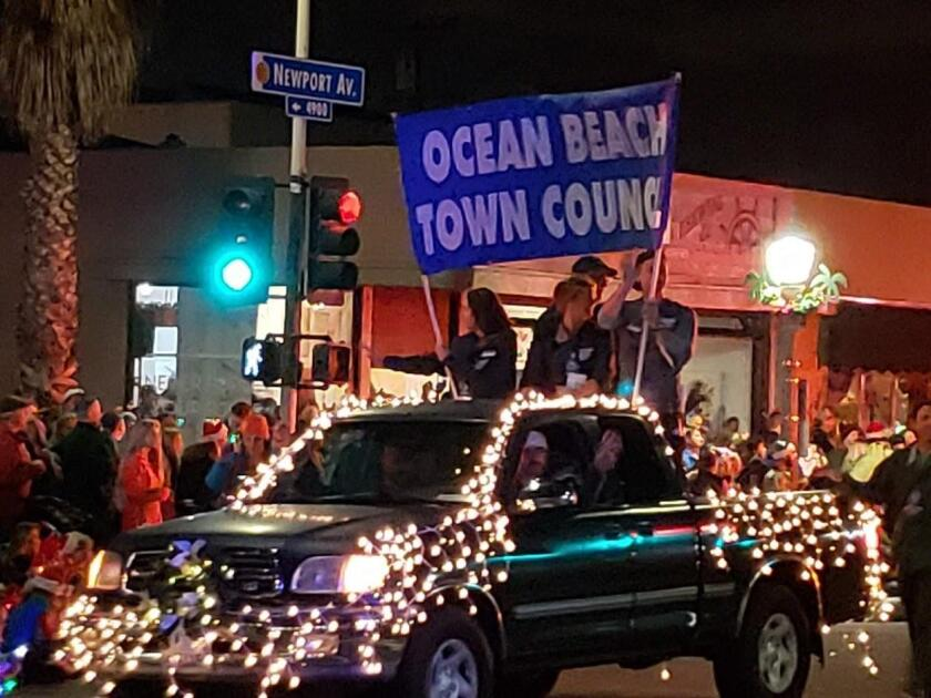 OB Town Council members wave to onlookers.