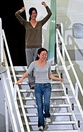 Journalists Laura Ling, top, and Euna Lee arrive in Burbank. They returned with former President Clinton after he had secured their release from North Korea. The two journalists were on assignment for San Francisco-based Current TV, a cable and satellite channel co-founded by former Vice President Al Gore, when they were arrested at the China-North Korea border.