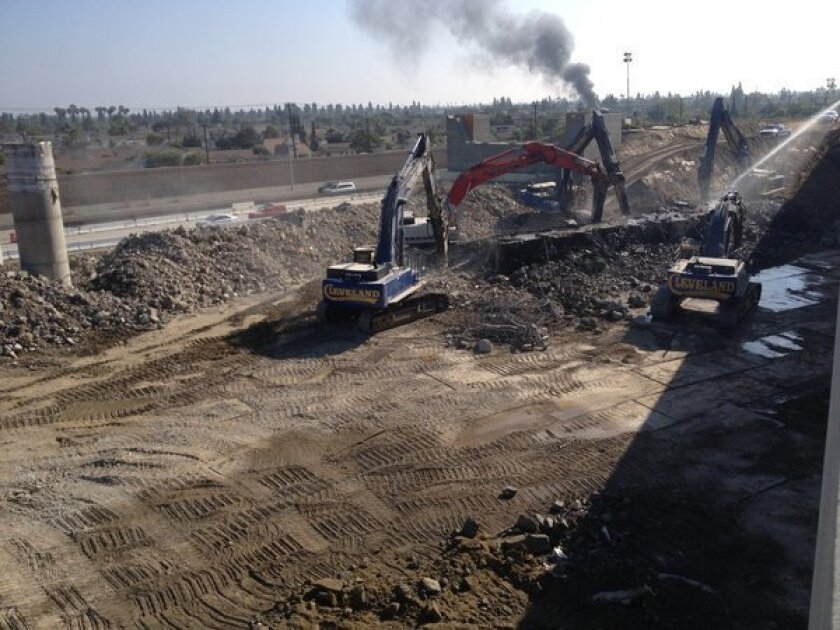 Crews work to remove a bridge on the 405 Freeway in Orange County.