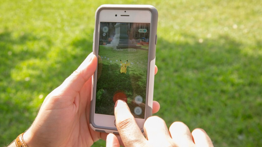 A man snatched a smartphone from two teenagers playing 'Pokemon Go' in San Francisco.