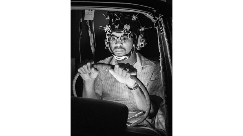 March 1977: Research assistant in automobile simulator used to test reactions to drug and alcohol at the Southern California Research Institute.