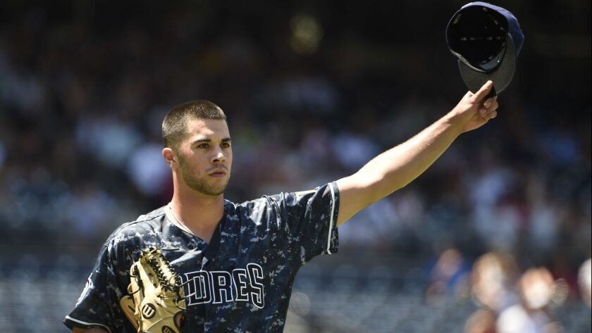 Joey Lucchesi tips his cap to Travis Jankowski after Jankowski made a catch in the outfield in the fourth inning Sunday against the Philadelphia Phillies.