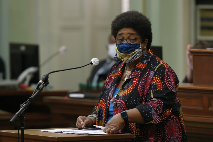 Assemblywoman Shirley Weber, D-San Diego, wears a face mask as she calls on lawmakers.