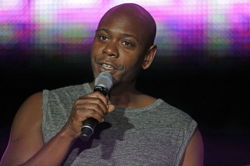 Santa Fe police say a man tossed a banana peel at Dave Chappelle during a show, hitting the comedian in the leg. Above, Chappelle performs in New Orleans in July 2014.
