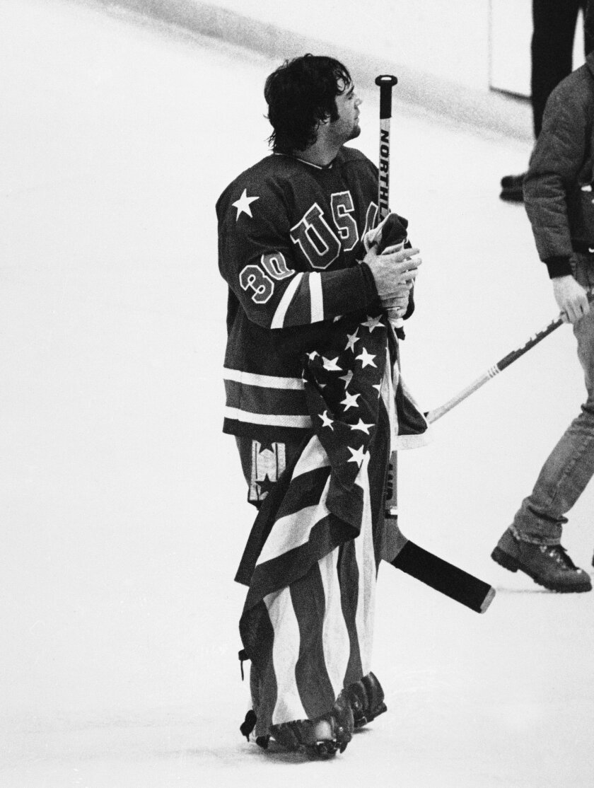 FILE - In this Feb. 24, 1980, file photo, Jim Craig, goalie for the USA Olympic hockey team, holds the American flag on the ice rink after defeating Finland at the XIII Winter Olympic Games in Lake Placid, N.Y. It's been more than three decades since his landmark goal became the centerpiece of the U.S. Olympic hockey team's Miracle on Ice. For 60-year-old Mike Eruzione, it still seems like only yesterday. (AP Photo/Dave Tenenbaum, File)