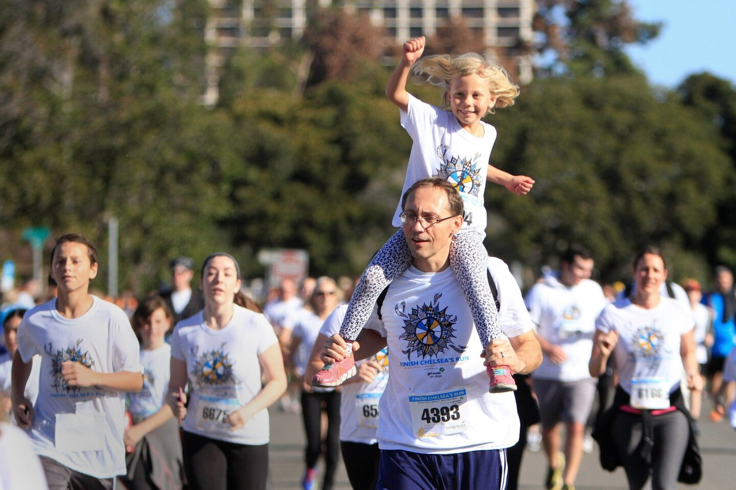 John Sedy and his daughter Karolina Sedy, 6, of University City participate in the fifth annual Finish Chelsea's Run charity fundraiser at Balboa Park Saturday.
